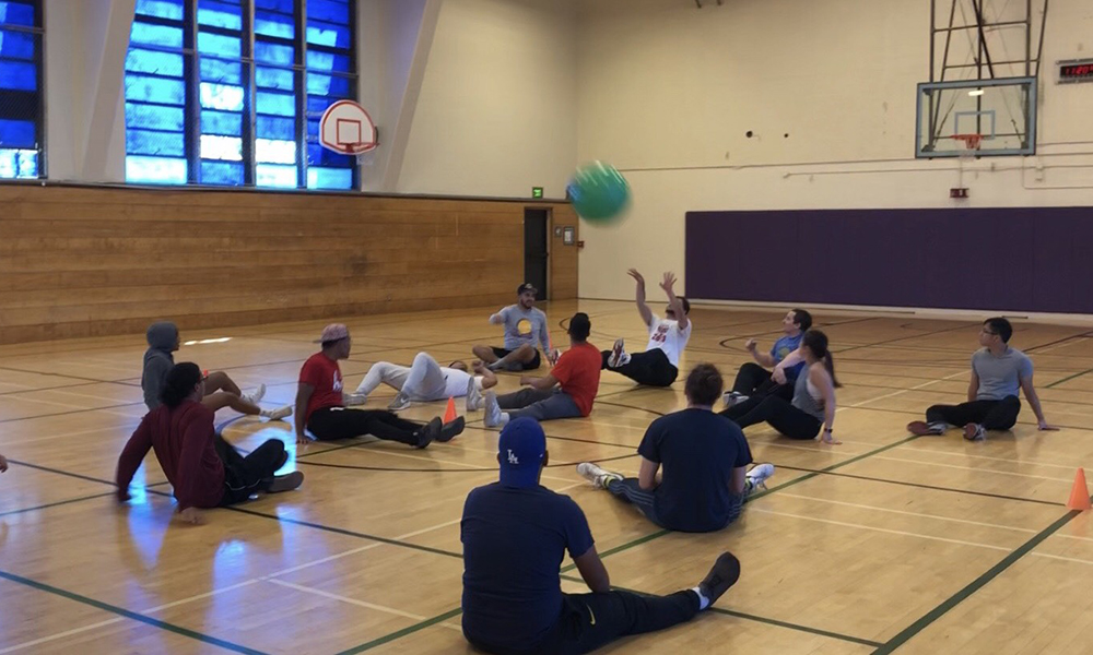 Kinesiology students practice sitting volleyball
