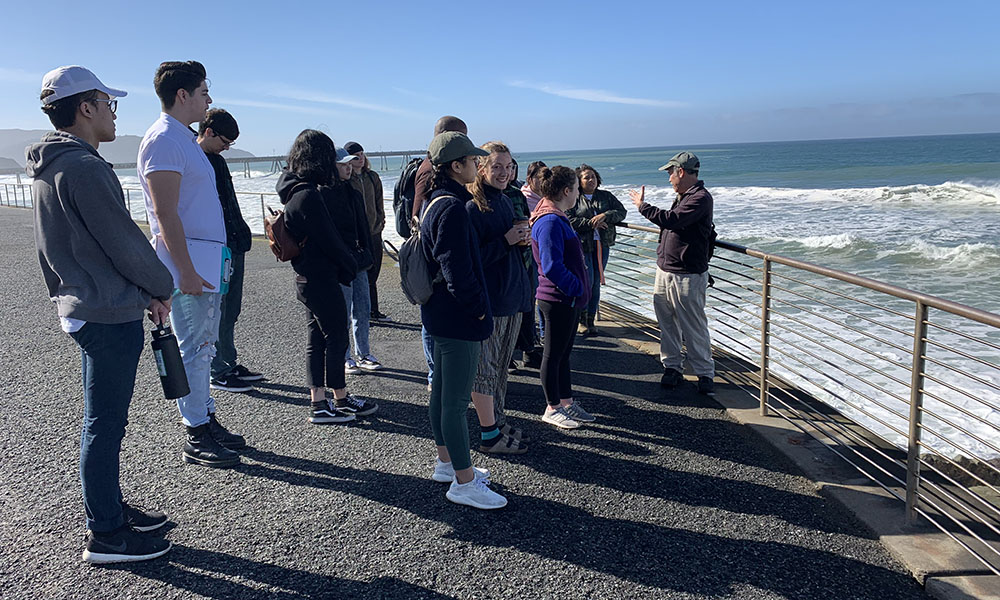 Students look at ocean in Pacifica
