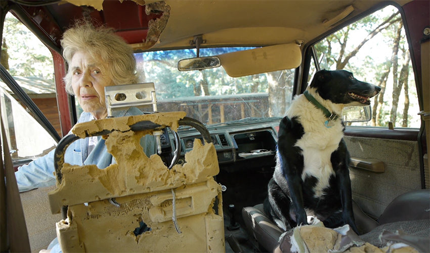 Sally Geahart in jeep in scene from A Great Ride