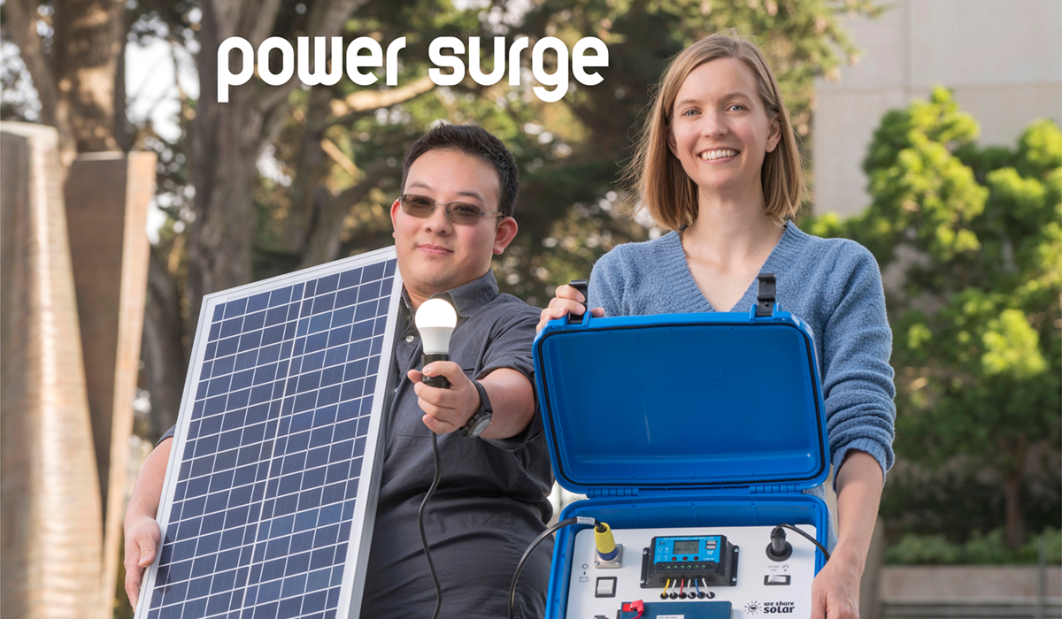 Jin Zhu and Autumn Thoyre with one of the solar suitcases