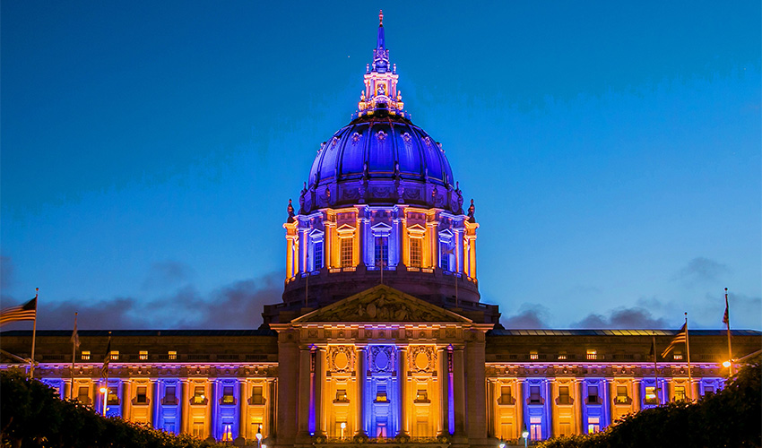 SF City Hall lit in purple and gold