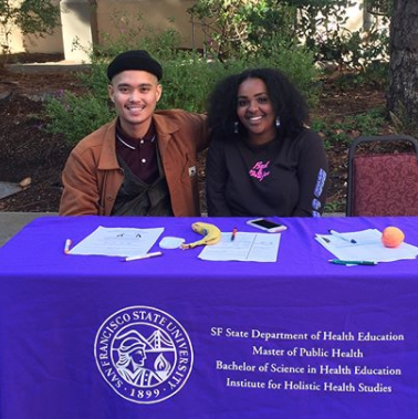 Health education students at an information table