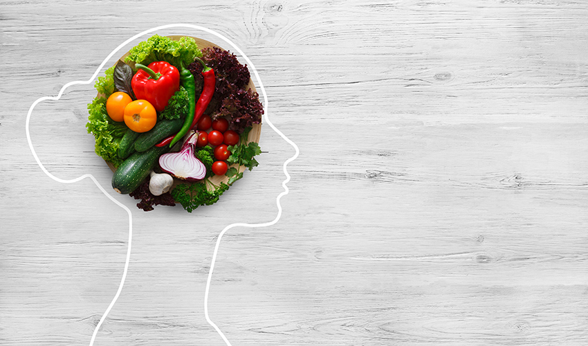 bowl of vegetables inside outline of woman's head