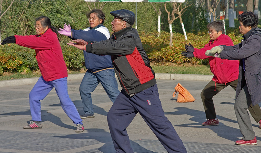 Asian elders do tai chi