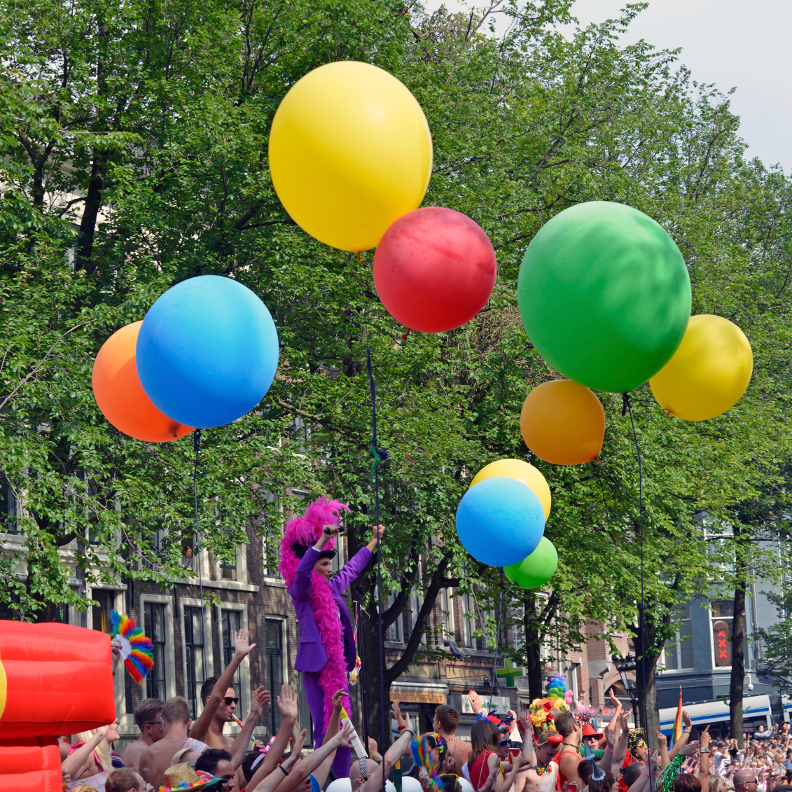 Crowds and balloons at a pride event