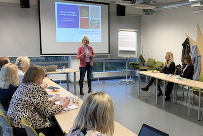 Paige Viren gives presentation in Estonia