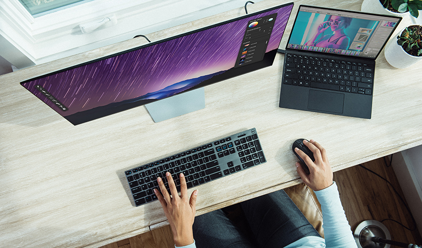 workstation with hands on keyboard
